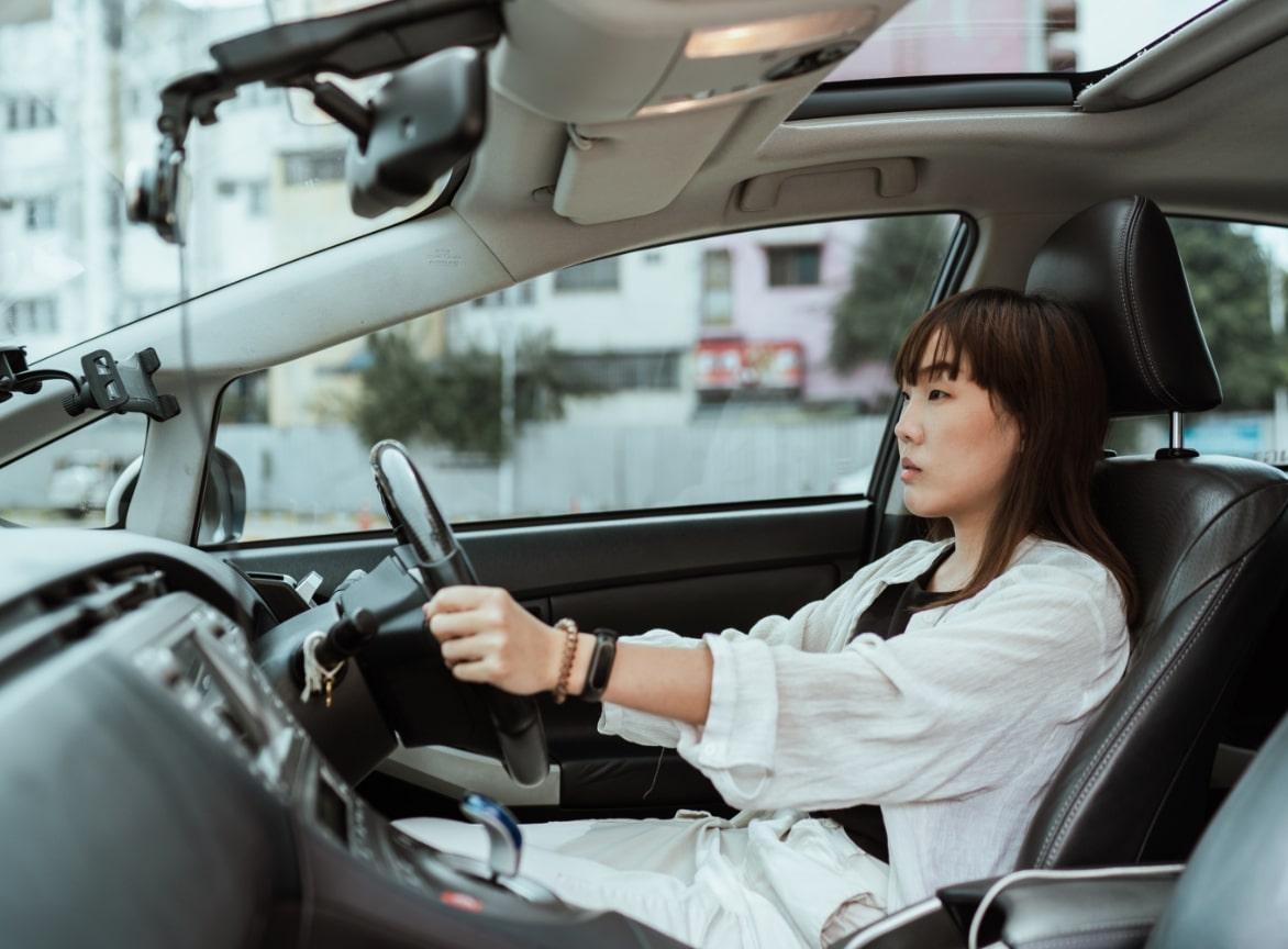 women sitting in car